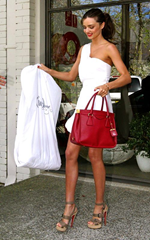 Red purse with white outfit