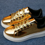 Shiny gold tennis shoes