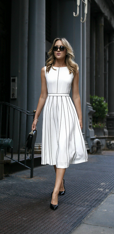 White dress with brown hems